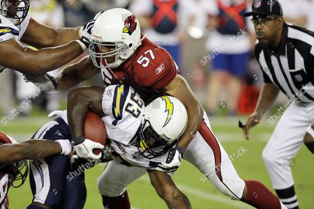 Victor Hobson, Gartrell Johnson San Diego Chargers' Gartrell Johnson (33) gets tackled by Arizona Cardinals' Victor Hobson (57) in the fourth quarter of a preseason NFL football game, in Glendale, Ariz. The Chargers defeated the Cardinals 17-6