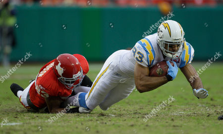 Vincent Jackson, Mike Richardson San Diego Chargers wide receiver Vincent Jackson (83) is tackled by Kansas City Chiefs cornerback Mike Richardson (23) during the first half of an NFL football game in Kansas City, Mo
