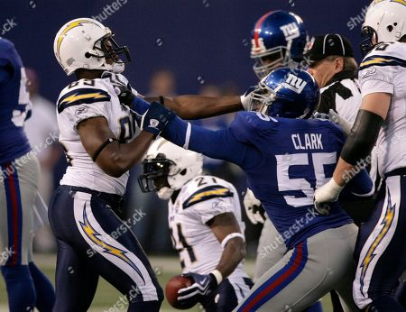 Louis Vasquez, Danny Clark San Diego Chargers guard Louis Vasquez (65), left, gets in a shoving match with New York Giants linebacker Danny Clark (55) during the NFL football game, in East Rutherford, N.J