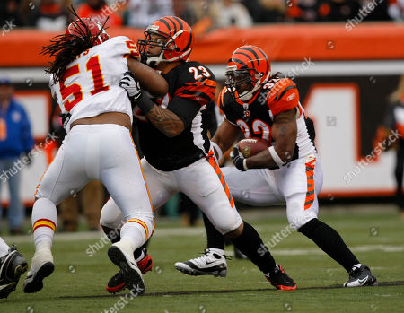 Cedric Benson, Corey Mays, Jeremi Johnson Cincinnati Bengals running back Cedric Benson (32) in action against the Kansas City Chiefs in the first half of an NFL football game, in Cincinnati. Bengals Jeremi Johnson blocks Chiefs Corey Mays (51