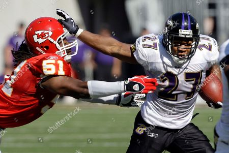 Ray Rice, Corey Mays Baltimore Ravens running back Ray Rice slips [ast Kansas City Chiefs linebacker Corey Mays during the NFL football game between the Baltimore Ravens and the Kansas City Chiefs, in Baltimore