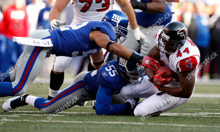 Jason Snelling, Danny Clark, Michael Boley Atlanta Falcons running back Jason Snelling (44), right, is tacked by New York Giants linebacker Danny Clark (55), center, and New York Giants linebacker Michael Boley (52) during the NFL football game between the New York Giants and the Atlanta Falcons, in East Rutherford, N.J