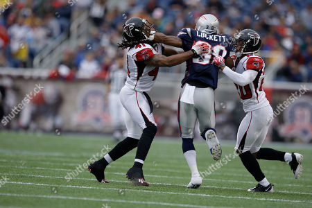Bret Lockett, Antoine Harris, Brent Grimes New England Patriots defensive back Bret Lockett, center, gets trapped by Atlanta Falcons safety Antoine Harris, left, and corner back Brent Grimes during an NFL football game in Foxborough, Mass