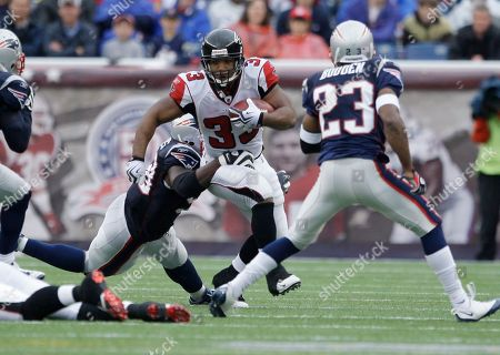 Bret Lockett, Michael Turner New England Patriots defensive back Bret Lockett, left, tries to catch Atlanta Falcons running back Michael Turner during an NFL football game in Foxborough, Mass