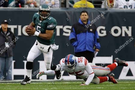 Donovan McNabb, Danny Clark Philadelphia Eagles quarterback Donovan McNabb runs with the ball as New York Giants linebacker Danny Clark dives at him from behind during the first quarter of an NFL football game, in Philadelphia