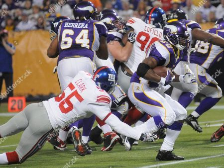 Adrian Peterson, Danny Clark New York Giants linebacker Danny Clark (55) dives after a running Minnesota Vikings running back Adrian Peterson (28) during the first quarter of an NFL football game on at the Metrodome in Minneapolis. The Vikings defeated the Giants 44-7