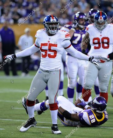 Adrian Peterson, Danny Clark New York Giants linebacker Danny Clark (55) celebrates after tacking Minnesota Vikings running back Adrian Peterson in the first quarter during an NFL football game against the New York Giants in Minneapolis