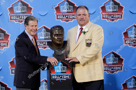 Russ Grim, right, with presenter Joe Bugel after Grimm's enshrinement in the Pro Football Hall of Fame in Canton, Ohio