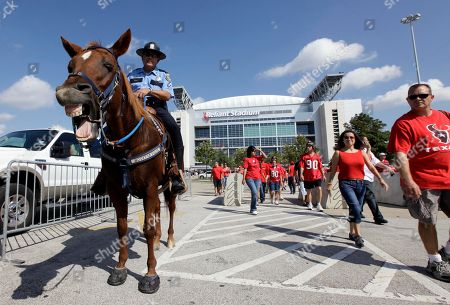 David Curry Houston Police Officer David Curry sits on his horse as he watches the crowd outside Reliant Stadium before a NFL football game between the Houston Texans and Jacksonville Jaguars in Houston