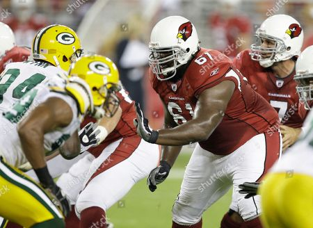 Stock Photo of Elton Brown, Matt Leinart Arizona Cardinals guard Elton Brown (61) blocks for Matt Leinart, back right, against the Green Bay Packers in the fourth quarter of an NFL preseason game in Glendale, Ariz. The Packers defeated the Cardinals 44-37