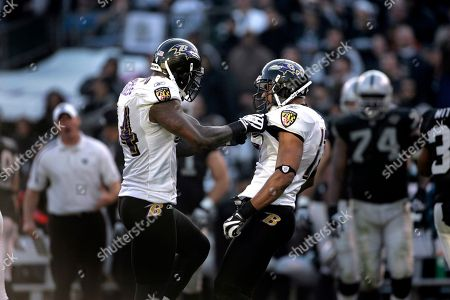 Prescott Burgess David Tyree Baltimore Ravens linebacker Prescott Burgess (54) and wide receiver David Tyree (17) in action during the third quarter of an NFL football game in Oakland, Calif