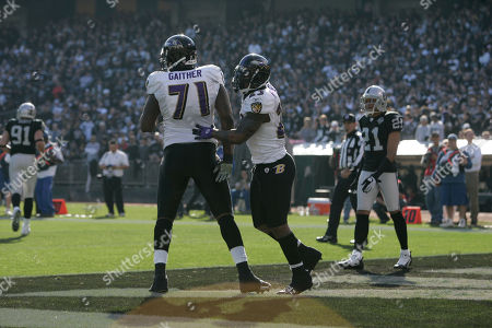 Willis McGahee, Jared Gaither Baltimore Ravens running back Willis McGahee (23) celebrates with offensive tackle Jared Gaither (71) after scoring on a 2-yard touchdown run against the Oakland Raiders in the first quarter of an NFL football game in Oakland, Calif