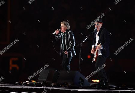 Roger Daltry, left, and Pete Townshend of The Who perform during halftime of the NFL Super Bowl XLIV football game in Miami