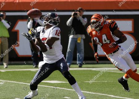 Jacoby Jones, Kyries Hebert Houston Texans punt returner Jacoby Jones (12) catches a punt in front of Cincinnati Bengals safety Kyries Hebert (34) in the first half of an NFL football game, in Cincinnati