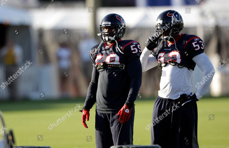 Houston Texans linebacker DeMeco Ryans (59) and linebacker Danny Clark (53) during a NFL football training camp practice in Houston