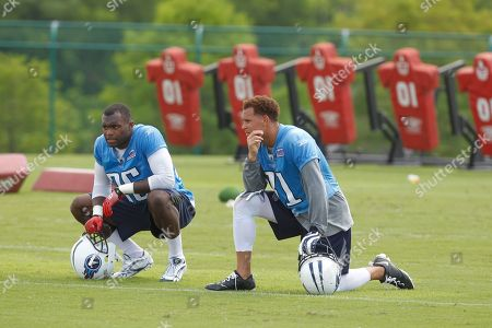 Tennessee Titans safety Myron Rolle (25) talks with cornerback Cortland Finnegan (31) during an NFL football minicamp, in Nashville, Tenn