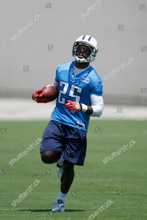 Tennessee Titans safety Myron Rolle practices during an NFL minicamp workout, in Nashville, Tenn