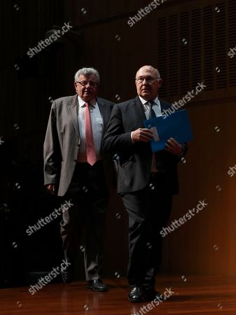 France's Finance and Economy Minister Michel Sapin, right, and junior minister for Budget Christian Eckert arrive for a press conference in Paris, . The French government is presenting its 2017 budget, including 1-billion euro ($1.1 billion) in tax cuts that are expected to benefit to 5 million modest and middle-class households