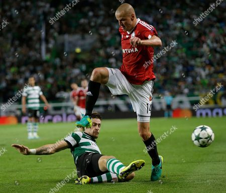 Adam Hlousek, Joao Pereira Legia's Adam Hlousek, right, is tackled by Sporting's Joao Pereira during a Champions League, Group F soccer match between Sporting and Legia Warsaw at the Alvalade stadium in Lisbon