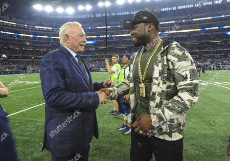 Stock Picture of Rapper and Actor Curtis James Jackson III, also known as 50 Cent walks on the field and meets with Cowboys Owner/General Manager Jerry Jones before the Dallas Cowboys game a Sunday Night Football NFL game between the Chicago Bears and the Dallas Cowboys at AT&T Stadium in Arlington, TX Dallas defeated Chicago 31-17 Albert Pena/CSM
