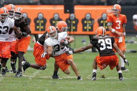 Noah Herron, Bret Lockett Cleveland Browns running back Noah Herron (33) runs past safety Bret Lockett (39) during practice at the team's NFL football training camp in Berea, Ohio