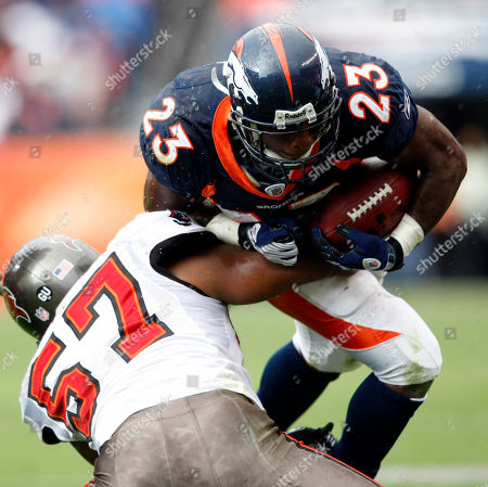 Andre Hall, Adam Hayward Denver Broncos running back Andre Hall, right, is stopped by Tampa Bay Buccaneers linebacker Adam Hayward in the third quarter of the Broncos' 16-13 victory in an NFL football game in Denver on
