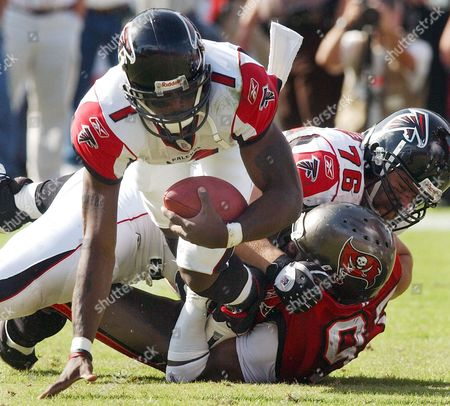 RICE VICK SHAFFER Tampa Bay Buccaneers defensive end Simeon Rice, 97, lower right, sacks Atlanta Falcons quarterback Michael Vick during the Buccaneers 27-0 win in Tampa, Fla. Rice recorded his 100th and 101st career sacks during the game, becoming one of 22 players in NFL history to record 100 or more sacks in their career. Atlanta's Kevin Shaffer (76) tries to defend