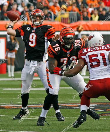 Carson Palmer, Levi Jones, Darryl Blackstock Cincinnati Bengals quarterback Carson Palmer (9) passes as tackle Levi Jones (76) blocks Arizona Cardinals linebacker Darryl Blackstock (51) in an NFL football game, in Cincinnati