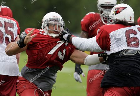 Stock Image of Keilen Dykes, Elton Brown Arizona Cardinals' Keilen Dykes, left, tries to get around Elton Brown during afternoon practice at Cardinals NFL football training camp, in Flagstaff, Ariz