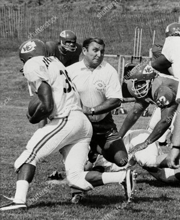 Hank Stram Hank Stram, coach of the champion Kansas City Chiefs, hands off to Richard Armstrong (35) during a workout and scrimmage of the rookie squad as season's practice got underway in Liberty, Mo., . Stram played the role of quarterback as the rookies learned plays and positions, with only coaches to help them. The veteran players did not show due to the deadlocked negotiations between NFL owners and NFL Player Association