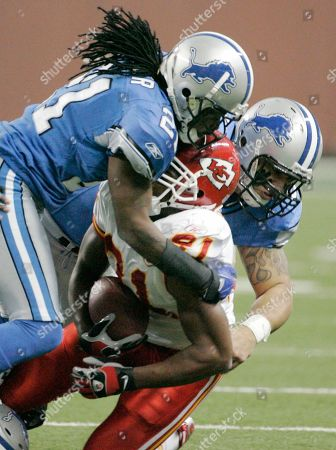 Travis Fisher, Kolby Smith, Ikaika Alama-Francis Detroit Lions' Travis Fisher (21), left, and Ikaika Alama-Francis, right, tackle Kansas City Chiefs running back Kolby Smith for a one-yard loss in the first quarter of a football game, in Detroit. The Lions beat the Chiefs, 25-20