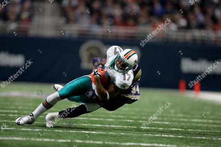 Brandon London, Fakhir Brown Miami Dolphins wide receiver Brandon London (17) is pulled down by St. Louis Rams cornerback Fakhir Brown after catching a pass during the second quarter of an NFL football game, in St. Louis