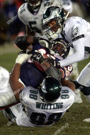 THOMAS WHITING TAYLOR Chicago Bears running back Anthony Thomas (35) is tied up by Philadelphia Eagles' Brandon Whiting (98) and Bobby Taylor, top, during the second half of the NFC Divisional Playoff game at Soldier Field in Chicago