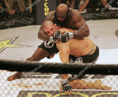Kimbo Slice, James Thompson Kimbo Slice, top, has James Thompson of Manchester, England in a head lock during their EliteXC heavyweight bout at the Prudential Center in Newark, N.J