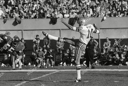 Stock Image of Mike McGill (55), top photo, deflects punt by Dallas kicker Rom Widby in NFL game a on in Minneapolis. Minnesota Vikings' 54-13 rout of Cowboys