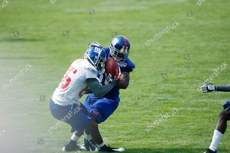 David Tyree, Sha'reff Rashad New York Giants wide receiver David Tyree, left, battles for the ball with defender Sha'reff Rashad during NFL football training camp in Albany, N.Y