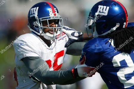 David Tyree, DeAndre Wright New York Giants wide receiver David Tyree (85) blocks cornerback DeAndre Wright during NFL football training camp in Albany, N.Y
