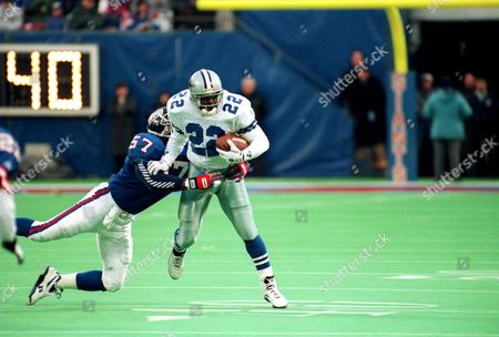 Smith Dallas Cowboys running back Emmitt Smith tries to break free from New York Giants' Corey Miller during the 4th quarter of their game at Giants Stadium in East Rutherford, N.J., . Smith, the fourth player to win three straight NFL rushing titles, suffered a right shoulder injury in second quarter of the game