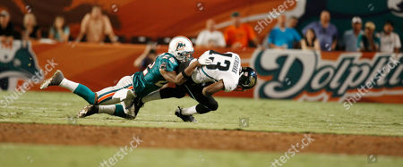 Stock Image of Joey Thomas Miami Dolphins Joey Thomas (22) tackles Jacksonville Jaguars' Michael Desormeaux (43) during preseason NFL football action in Miami