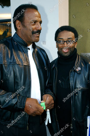 """LEE WILLIAMSON Director Spike Lee, right, poses with Fred Williamson, left, as they arrive for the Los Angeles premiere of """"Jim Brown: All American,"""", in Los Angeles. Lee directed the documentary feature for HBO about Brown, who was not at the movie's premiere. The former football star is serving a six-month jail sentence on domestic violence charges"""