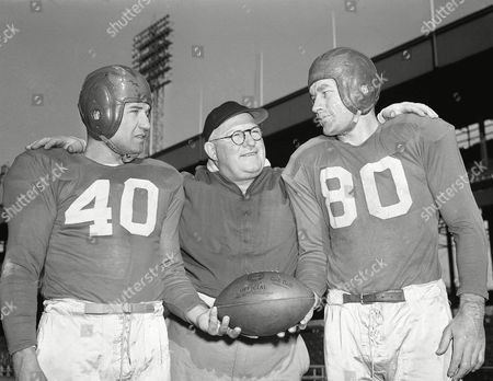 Watchf Associated Press Sports NFL Football New York United States APHS55663 NEW YORK GIANTS FOOTBALL Coach Steve Owen, center, of the New York Giants, discusses the championship game with Chicago Bears quarterback Frank Filchock, left, and end Jim Poole during a workout at the Polo Grounds in New York, on