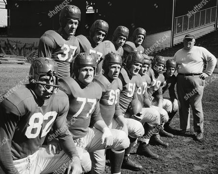 Watchf Associated Press Sports NFL Football New York United States APHS55662 NEW YORK GIANTS The 1947 New York Giants pose - 1st team, left to right: (82) Ray Poole; (77) Jim White; (60) Len Younce; (51) Chester Gladchuck; (67) Bob Dublestein; 79 DeWitt Coulter; (21) Joe Sulaitis; Backs, left to right: (37) George Franck; (57) Lou Palazzi ; (33) Gordon Paschka; (44) Francis Regan and coach Steve Owen