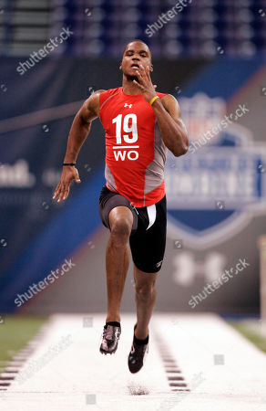 Aaron Kelly Clemson receiver Aaron Kelly runs a football drill at the NFL scouting combine in Indianapolis