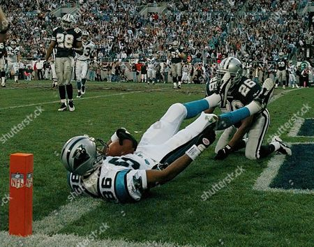 PANTHERS COWBOYS Carolina Panthers Willie Green (86) scores a second quarter touchdown against the Cowboys in their NFL Divisional playoff at Charlotte's Ericsson Stadium . Cowboy Kevin Smith (26) loks on 1997