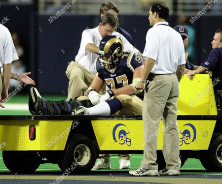 WILLIAMS Members of the St. Louis Rams training staff attend to offensive lineman Grant Williams (77) in the first half of their football game against the Oakland Raiders during their NFL football game in St. Louis . Williams was cartred off the field