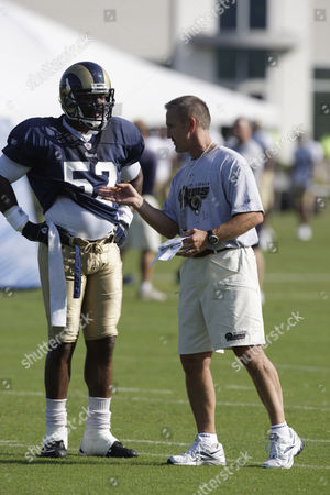 Steve Spagnuolo, Chris Draft St. Louis Rams head coach Steve Spagnuolo, right, talks with linebacker Chris Draft during NFL football training camp, at the Rams' training facility in St. Louis