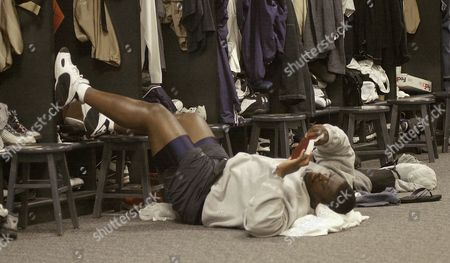 JONES St. Louis Rams offensive lineman Rod Jones rests on the floor at Rams Park in St. Louis, while reading his Bible, . The Rams are preparing to play the Green Bay Packers in a second-round NFL playoff game Sunday, in St. Louis