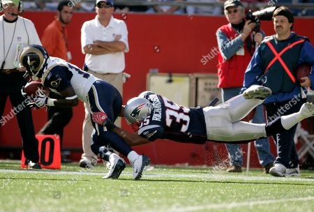 Donnie Avery, Mike Richardson St. Louis Rams wide receiver Donnie Avery (17) is tackled by New England Patriots defensive back Mike Richardson (35) in an NFL football game in Foxborough, Mass., . The Patriots beat the Rams 23-16