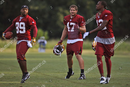 Santana Moss, Chris Cooley, Malcolm Kelly Washington Redskins from left, wide receiver Santana Moss (89), tight end Chris Cooley (47) and wide receiver Malcolm Kelly (12) take part in drills during NFL football training camp at Redskins Park in Ashburn, Va