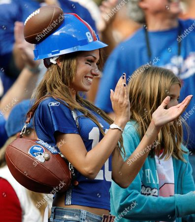 Stock Image of Reby Sky, 22 of Tampa, Fla. cheers on the Giants during their 44-6 victory over the Seattle Seahawks in their NFL football game in East Rutherford, N.J